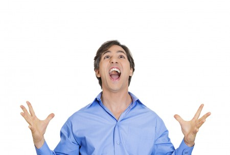 Closeup portrait excited energetic happy, screaming student, business man winning, arms,hands in air, celebrating success isolated white background. Positive human emotion, facial expression, reaction